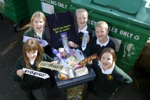 Children with recyclable material labels