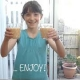 Young girl holding up two classes of homemade smoothie