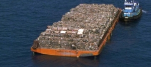 Close up of the real garbage barge, a boat that travelled the length of the USA to find a disposal site for its rubbish