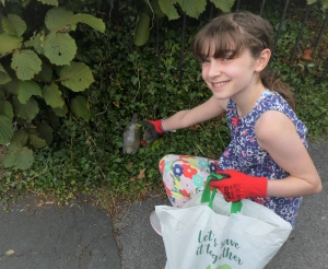 Girl collecting litter