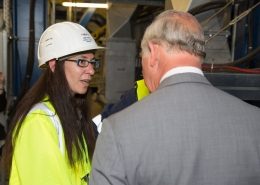 Image of woman in hard hat and high viz jacket talking about the Energy from Waste plant