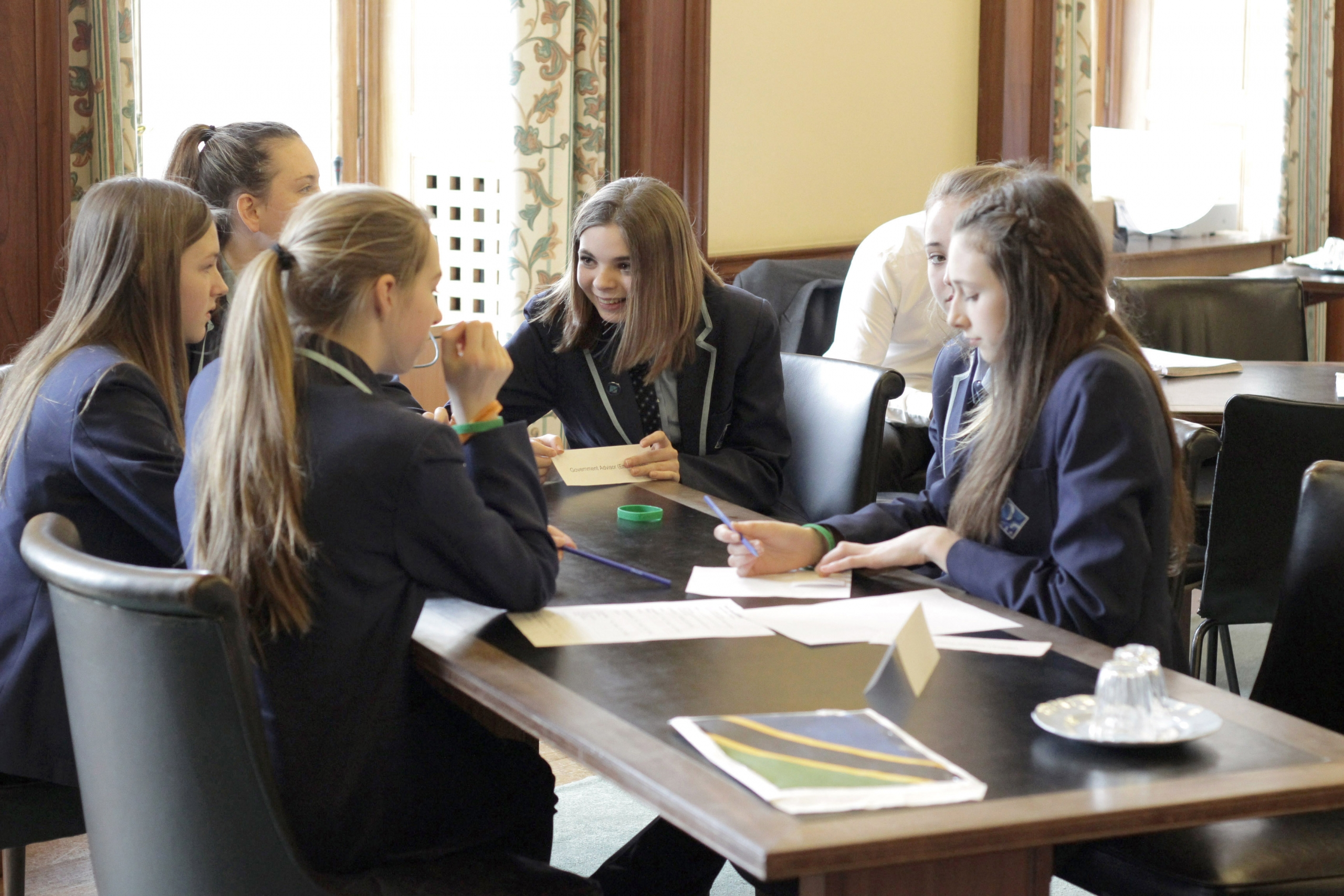 students talk through a problem in a team