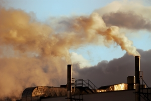 Picture of chimneys with yellow coloured smoke emerging