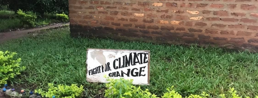 a sign saying Fight for Climate Change in a school garden in Tanzania