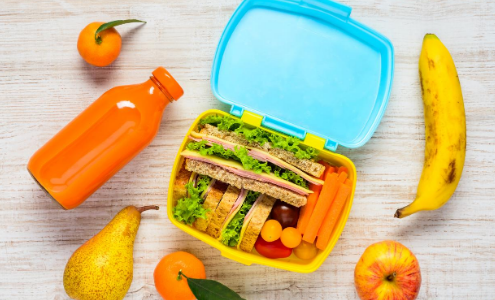 Reusable lunchbox with drinks bottle and fruit