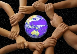 Picture of hands joined around a globe