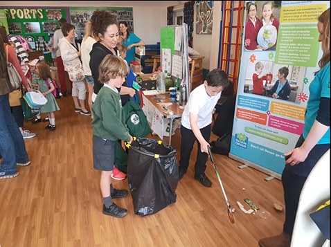 picture of school pupils at St Peters Primary in Budleigh enjoying a litter picking game with the Devon waste education team
