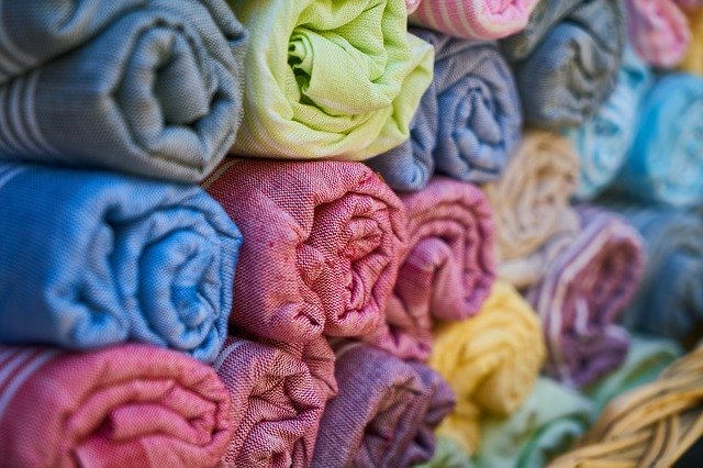 Bright colourful rolled up textiles