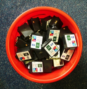 Bin full of used printer cartridges